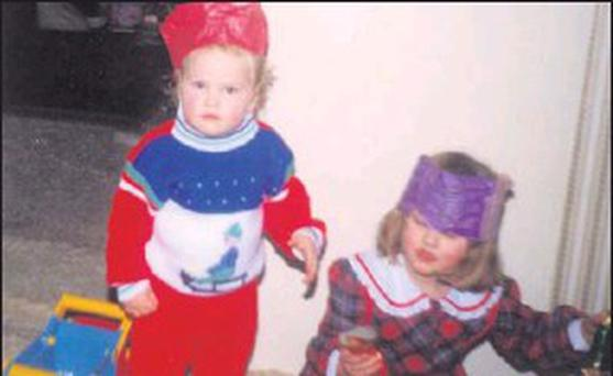 ■ Marcus Moore, pictured as a two-year-old at Christmas, with his sister, Lisa, who was four-and-a-half at the time. This photo was taken when the family lived in Stillorgan, Dublin.