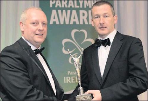 ■ Sligo-born broadcaster Adrian Eames receiving the radio award from Cecil Ryan, OCS Europe, sponsors, at the inagural OCS Irish Paralympic Awards.
