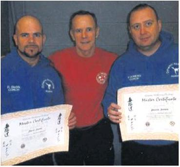Congratulations to Wexford pair Robbie Sludds and Packy Somers on receiving their fifth degree black belts in Dublin recently. Here they are being presented with their certificates by Master Pat White.