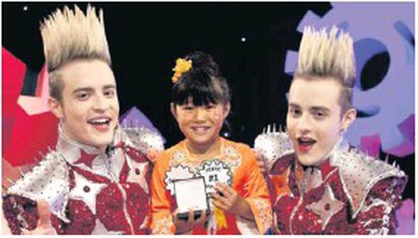 A very proud Sophie Mei appears with Jedward on their Dream Factory show.