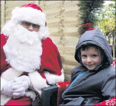 Marc Houlihan having a chat with Santa at the Glanbia CountryLIfe Garden Centre in Ashford.