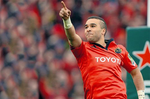 Simon Zebo points the way for Munster as he celebrates one of his three tries against Racing Metro at Thomond Park