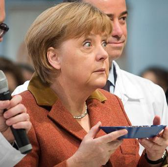 Angela Merkel's hopes for another four-year term in a national parliamentary election have taken a knock (AP/dpa, Michael Kappeler)