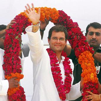 Rahul Gandhi waves to the crowd during an election rally in Amethi, India (AP/Manish A)