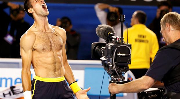 20 January, 2013: Novak Djokovic celebrates defeating Stanislas Wawrinka of Switzerland in their men's singles match at the Australian Open. Photo: Reuters