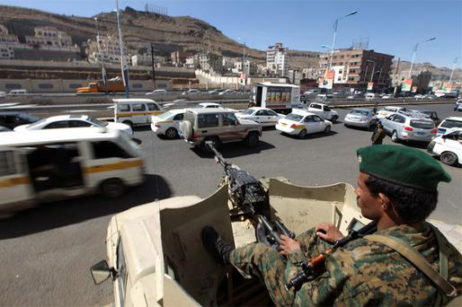 An army soldier sits on a military vehicle as they secure a checkpoint on a street in Sanaa. Photo: Reuters
