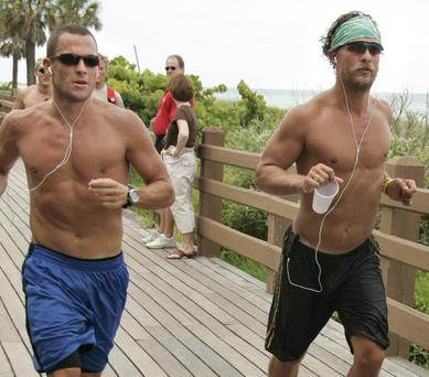 Matthew McConaughey and Lance Armstrong jogging on Miami Beach in 2006
