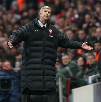 Arsene Wenger, pictured, was left fuming with Martin Atkinson