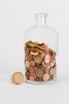 coins in glas bottle