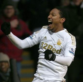 Jonathan de Guzman would be happy to stay at Swansea