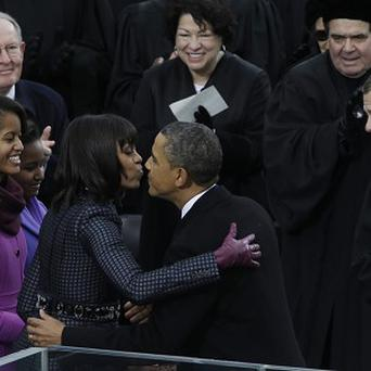 President Barack Obama kisses his wife Michelle after the ceremonial swearing-in (AP)