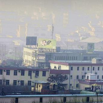 Afghan security forces take positions on top of the Kabul traffic police headquarters during an insurgent attack (AP)