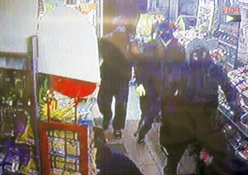 A CCTV image of the armed raid of the Costcutter shop in Lusk, Co Dublin