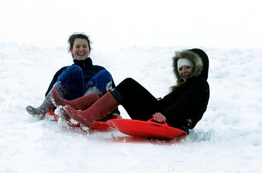 Mairead Reddan & Katie Finn both from Kilmacanogue have fun in the snow in Kilmacanogue, Co. Wicklow. Photo: Collins