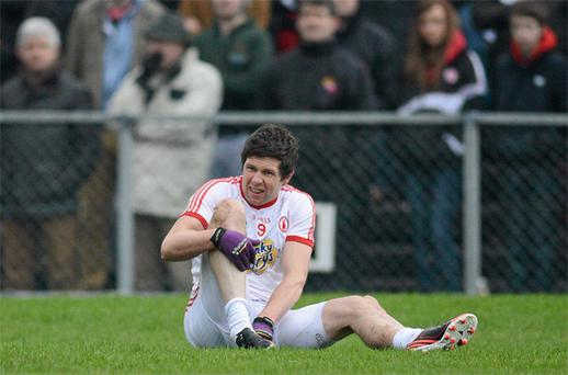 Sean Cavanagh replaces his boot after being fouled in the Dr McKenna Cup clash against Antrim