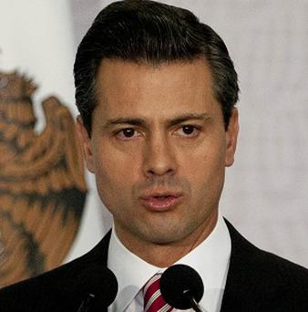 President Enrique Pena Nieto says a campaign to feed the poor will target Mexico's 400 poorest districts (AP)