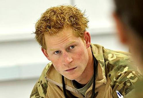 Previously unissued picture of Prince Harry or just plain Captain Wales as he is known in the British Army, at a mission briefing in the British controlled flight-line in southern Afghanistan.