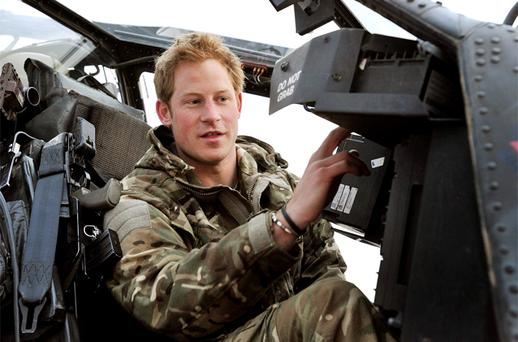 Britain's Prince Harry performs a pre-flight check on his Apache Helicopter after starting his 12 hour VHR (very high ready-ness) shift at the British controlled flight-line in Camp Bastion, southern Afghanistan. Photo: Reuters