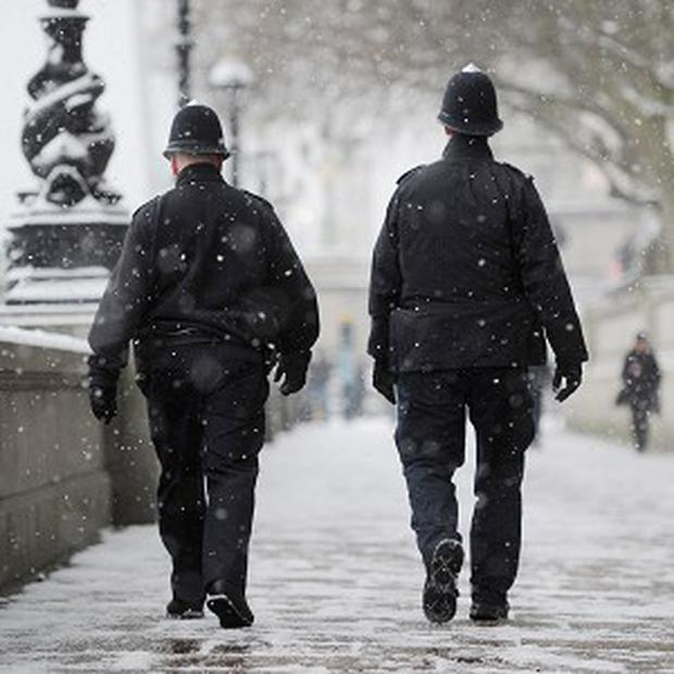 Police officers will be issued with woolly hats to help fight the cold
