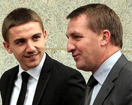Defendant Anton Rodgers with his father Brendan Rodgers, outside the Old Bailey, London.