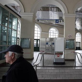 A elderly man passes a closed metro station during a strike in Athens (AP)
