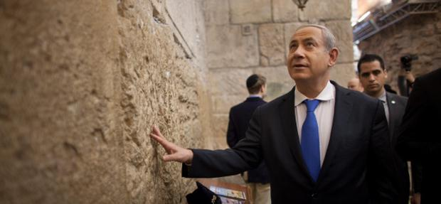 Israeli Prime Minister Benjamin Netanyahu touches the Western Wall, Judaism holiest site, earlier today. Photo: Getty