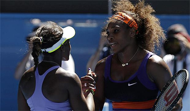 Sloane Stephens, left, is congratulated by Serena Williams after winning their quarterfinal match at the Australian Open