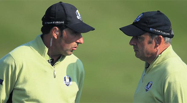 Europe's team captain Paul McGinley (R) is eager to keep playing golf competitively, just like his predecessor in the role Jose Maria Olazabal