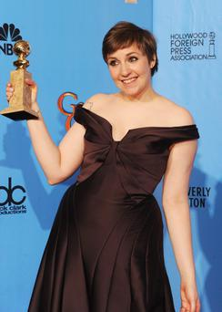 "BEVERLY HILLS, CA - JANUARY 13: Actress Lena Dunham, winner of Best Actress in a Television Series (Musical or Comedy) for ""Girls,"" poses in the press room during the 70th Annual Golden Globe Awards held at The Beverly Hilton Hotel on January 13, 2013 in Beverly Hills, California. (Photo by Kevin Winter/Getty Images)"