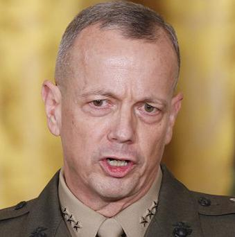 General John Allen, the top US commander in Afghanistan, has been cleared of sending inappropriate emails to a woman (AP)