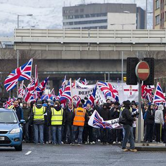 Traders claim the cumulative effect of flag protests has dealt a hammer blow to footfall in the city