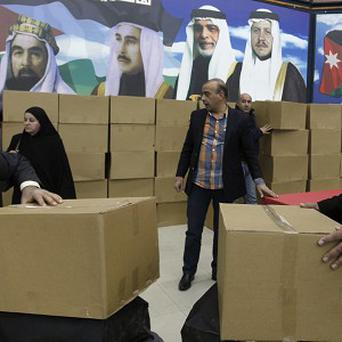 Members of the Jordanian Independent Electoral Commission check boxes of ballots to be distributed to the polling stations (AP)