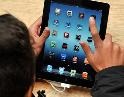 iPad 3 launch...Customers view the new Apple iPad 3 at the company's Covent Garden store on the release of the latest version of the tablet computer. PRESS ASSOCIATION Photo. Picture date: Friday March 16, 2012. See PA story TECHNOLOGY iPad. Photo credit should read: Ian Nicholson/PA Wire...A