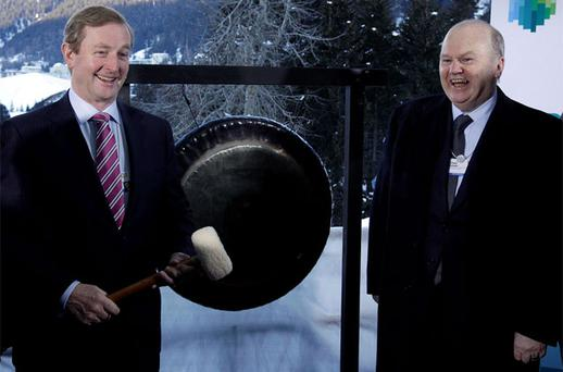 Taoiseach Enda Kenny and Finance Minister Michael Noonan ring the bell to open the Europe stock exchange. Photo: Reuters