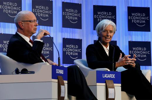 International Monetary Fund (IMF) chief Christine Lagarde addresses the annual meeting of the World Economic Forum (WEF), next to WEF founder Klaus Schwab (L), in Davos. Photo: Reuters