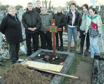 Relatives Ann Browne, Richard Miskella (son), Tommy Smiley, John Miskella (son), Sharon Browne, Catriona Parle, Tanya Miskella and Deirdre Miskella at the grave at Crosstown cemetary in Wexford from which the remains of the late Sean Miskella were exhumed