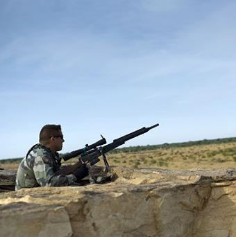 A French soldier take position in the outskirts of Sevare, Mali, some 385 miles north of Bamako (AP)