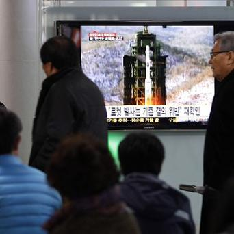 People in Seoul, South Korea, watch TV footage of last month's Unha rocket launching in North Korea (AP)