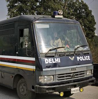 A Delhi police van carrying the accused over the gang rape of a 23-year-old woman enters a district court (AP)