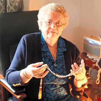Julia O'Donnell at home in Kincasslagh, Co Donegal, with the rosary beads sent to her by the Pope after she had sent him a pair of hand-knitted socks