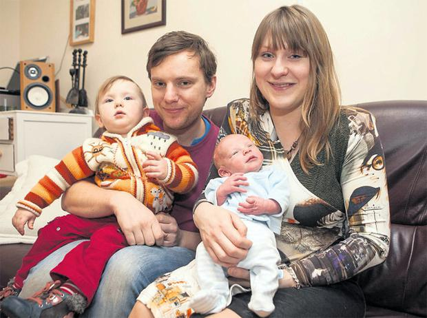 Ronan and Asia Smith with their daughter Sophie and new addition Jakub at home in Gort, Co Galway