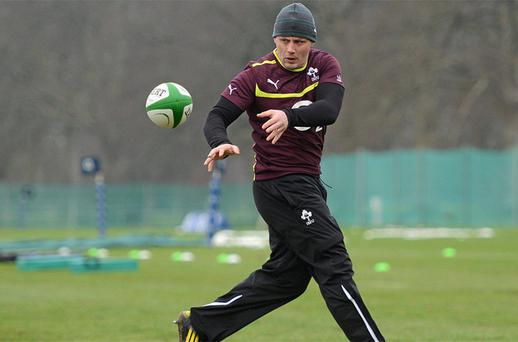 James Coughlan, who will captain the Irish Wolfhounds against the Saxons tonight, fires off a pass at training in Carton House yesterday
