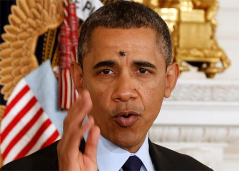 A fly lands between the eyes of US President Barack Obama while he speaks in the State Dining Room of the White House