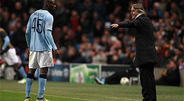 Manchester City manager Roberto Mancini and Mario Balotelli