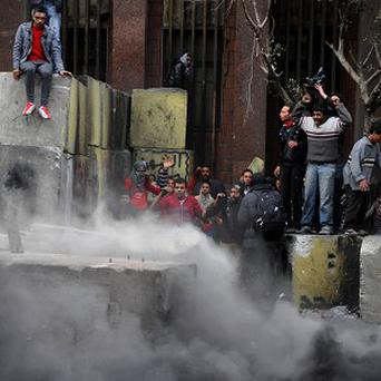 Egyptian protesters tear down a cement wall built near the parliament building in Cairo (AP)