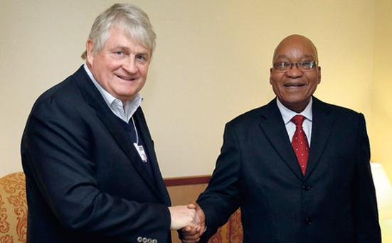 Denis O'Brien, chairman of Digicel, greets Jacob Zuma, president of South Africa, at the Hotel Seehoff in Davos, Switzerland, yesterday.