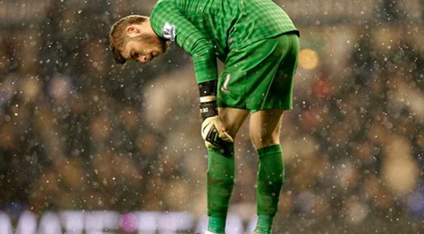 Manchester United goalkeeper David De Gea stands dejected after conceding a late equaliser to Tottenham Hotspur