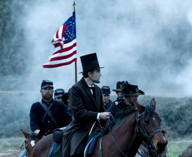Daniel Day-Lewis as Abraham Lincoln looks acaross a battlefield