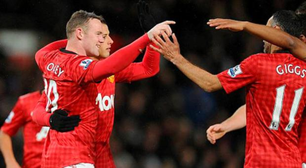 Manchester United's Wayne Rooney (left) celebrates scoring their second goal of the game with team-mates