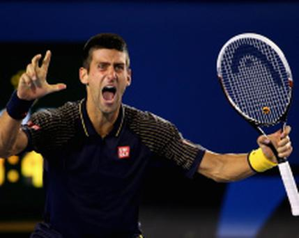 MELBOURNE, AUSTRALIA - JANUARY 27: Novak Djokovic of Serbia celebrates winning championship point in his men's final match against Andy Murray of Great Britain during day fourteen of the 2013 Australian Open at Melbourne Park on January 27, 2013 in Melbourne, Australia. (Photo by Cameron Spencer/Getty Images)